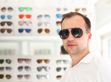 Man trying on new sunglasses Royalty Free Stock Image