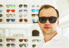 Man trying on new sunglasses at the opticians Royalty Free Stock Images
