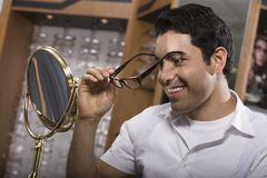 Man Trying On Spectacles Stock Photos
