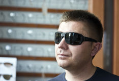 Man trying on sunglasses Stock Photo