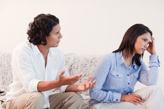 Man trying to apologize to his girlfriend. Young men trying to apologize to his girlfriend Royalty Free Stock Images