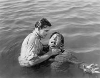 Man trying to drown and kill a man. (All persons depicted are no longer living and no estate exists. Supplier grants that there will be no model release issues royalty free stock images