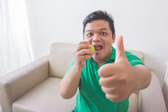 Man trying to eat healthy fresh food Stock Photos