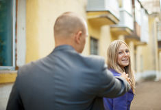 Man trying to get acquainted with woman. Man trying to get acquainted with women on city street Stock Photography