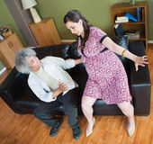 Man Trying to Help Pregnant Woman Stock Photography