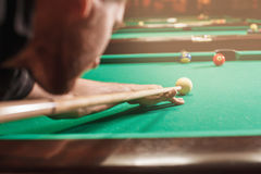 Man trying to hit the ball in billiard. Royalty Free Stock Images