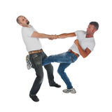 Man trying to kidnap another man, selfdefense, kicking in groin Royalty Free Stock Photo