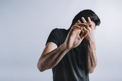 Man trying to protect himself with his arms Stock Photography