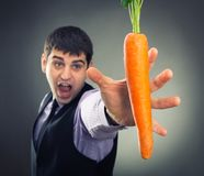 Man trying to reach carrot Royalty Free Stock Image