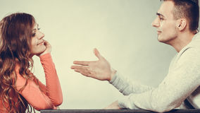 Man trying to reconcile with woman after quarrel. stock image