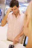 Man trying to remember card PIN number. Man at checkout trying to remember card PIN number Royalty Free Stock Photos
