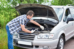 Man trying to repair broken car Royalty Free Stock Images