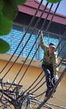 Man is trying to repair of electric wires Stock Images