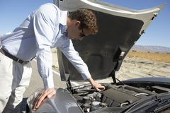 Man Trying To Repair His Car Royalty Free Stock Images
