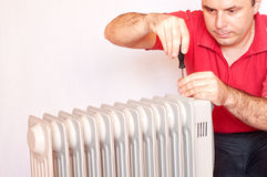Man trying to repair a radiator Royalty Free Stock Photography