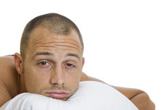 Man Trying to Sleep. Man in bed trying to sleep with a pillow Royalty Free Stock Image