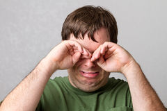 Man trying to take away the tears Royalty Free Stock Photos