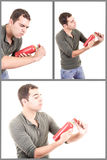 Man trying to use fire extinguisher Stock Photography