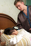 Man trying to wake his wife. (at home Stock Photos