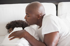 Man trying to wake partner Stock Photo