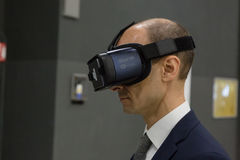 Man trying virtual reality headset at Technology Hub Stock Images