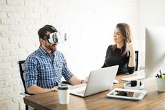 Man trying VR glasses Stock Images