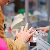 Man trying wedding rings at a jeweller Stock Image