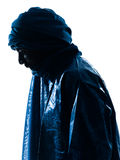 Man Tuareg Portrait silhouette. One Tuareg Portrait in silhouette studio isolated on white background stock photos