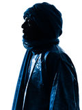Man Tuareg Portrait silhouette. One Tuareg Portrait in silhouette studio isolated on white background royalty free stock images