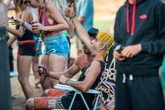 A man with the tufts of yellow hair screams during one of the dj sessions at the Lost Theory psytransce music festival