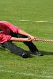 Man in tug of war. Competition at highland games Stock Photography