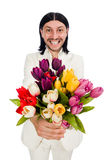 Man with tulip flowers isolated on white Stock Images