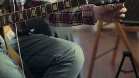Man tuning electric guitar slow motion stock video footage