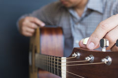 Man tuning guitar Stock Photo
