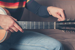 Man tuning guitar Stock Photos