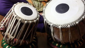 Man tuning on Indian tabla drums. Man tuning and playing on traditional Indian tabla drums close up stock footage