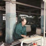 Man tuning machine Stock Photography