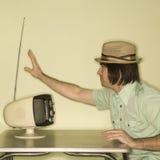 Man tuning in television. Royalty Free Stock Photos