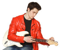 Man tuning up  his white electric guitar. Young man tuning up  his white electric guitar, over white background Stock Images