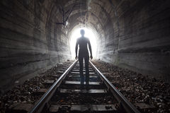 Man in a tunnel looking towards the light Royalty Free Stock Photos