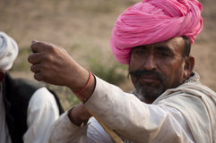 The man with a turban. Camel trader of Pushkar, Rajasthan, India wearing a pink turban Royalty Free Stock Photography