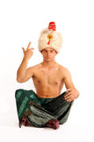 Man in turban gesture. Isolated on white Stock Photos