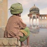 Man with turban. Hindu man with big turban meditating near Ganges Royalty Free Stock Photos