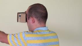 Man turn around holding virtual reality glasses. closeup stock video footage