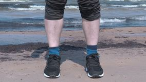 Man with the turn up trousers on the beach near sea stock footage