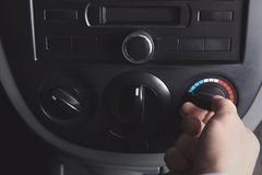 Man turning on air conditioner in car. Closeup Stock Photos