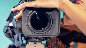 Cameraman is turning a camcorder round and it is zooming in. A man is turning a camcorder round and it is zooming in. 4K stock footage