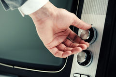 Man  turning channel knob Royalty Free Stock Images