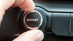Man turning a dial with the word Support. Man turning a dial or electronic control knob with the word Support on the top in a conceptual image Royalty Free Stock Images