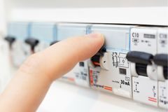 Man turning on the fusebox Royalty Free Stock Photo